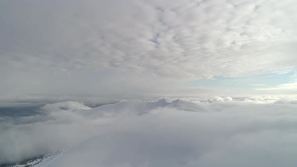 Thumbnail for Beautiful Mountain Day, Fly Over Cloudy Winter Land