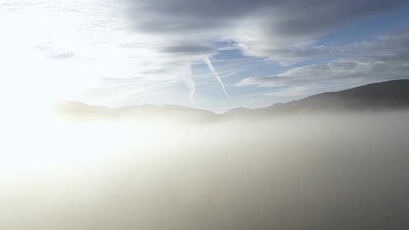 Thumbnail for Flying Above the Clouds in a Misty Morning