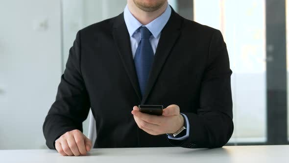 Thumbnail for Businessman Working with Smartphone at Office 24