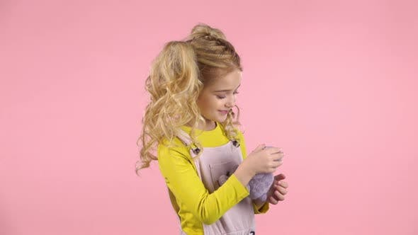 Thumbnail for Cute Blond Girl Is Hugging Her Teddy-bear. Slow Motion