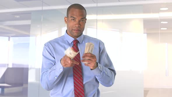 Thumbnail for Young businessman counting money