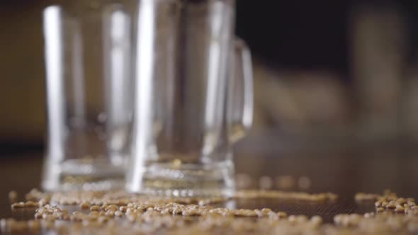 Thumbnail for Male Hand Puts a Half-empty Beer Glass on the Table