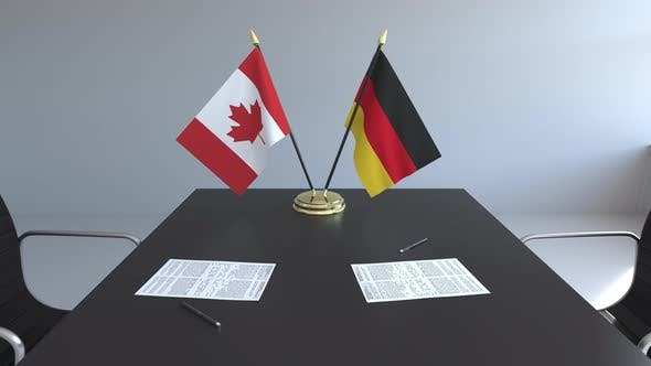 Thumbnail for National Flags of Canada and Germany on the Table