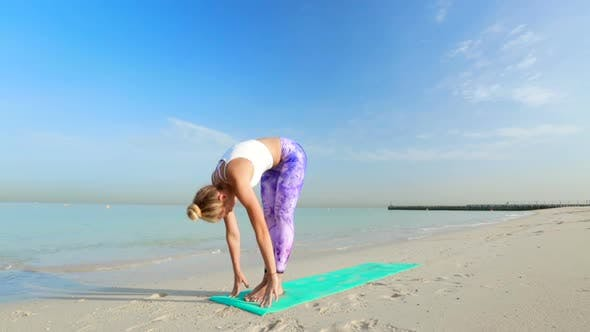 Thumbnail for Yoga Girl Doing Stretching Exercises by the Sea