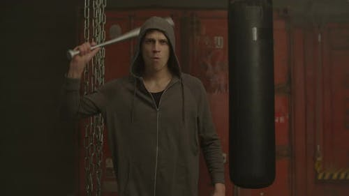 Hooligan in Hoodie Threatening with Baseball Bat