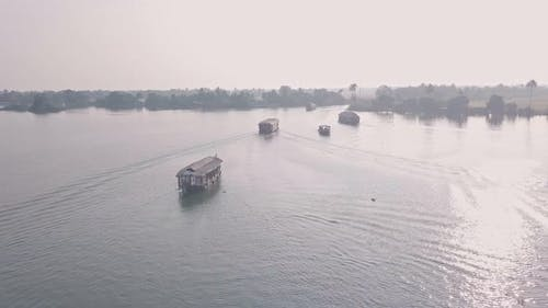 Houseboat trip in Kerala backwaters at Alleppey, India. Aerial drone view