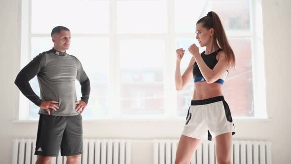 Woman Training Boxing with Personal Trainer. Instructor Teaching Female Boxer Fighting Practice