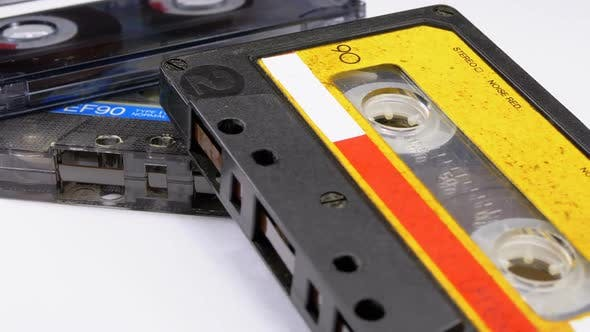 Cover Image for Three Vintage Audio Cassettes Rotate on White Background