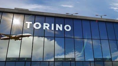 Airplane landing at Torino Italy airport mirrored in terminal