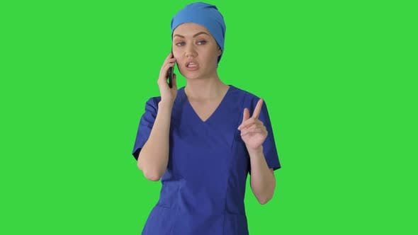 Thumbnail for Serious Female Doctor Talking on the Phone While Walking on a Green Screen, Chroma Key.