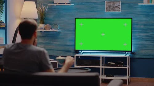 Person Watching Sport Event or Football on Green Screen