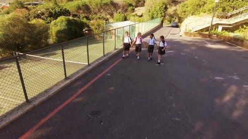 School kids walking in campus