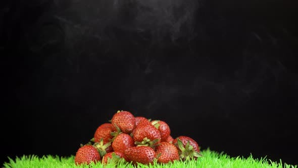 Thumbnail for Many Fresh Picked Red Strawberries on Grass Surface Against Black Background