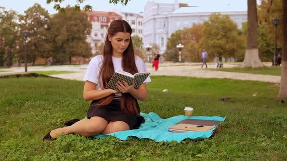 Girl Read Poem In Park De Vadosloginov En Envato Elements