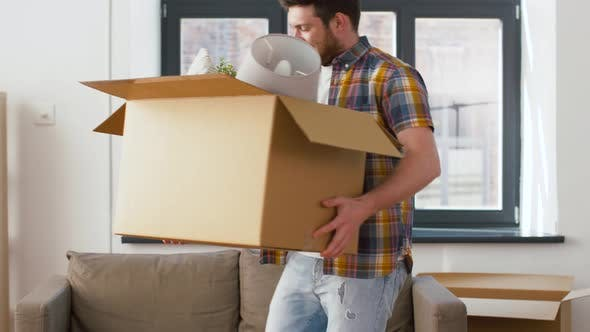 Cover Image for Happy Man with Box Moving To New Home
