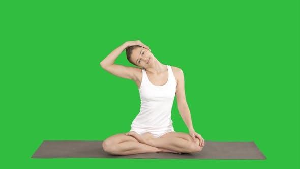 Thumbnail for Peaceful woman practising yoga sitting in Lotus pose,