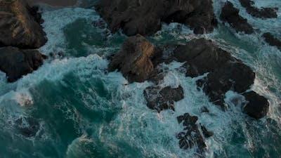 Waves Hitting Rocks