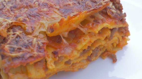 Lasagne on plate  traditional Italian cusine food 4K 2160p UHD panning   footage  - Lasagne food on