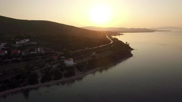 Thumbnail for Flying Over Sea and Trikorfo Beach Coastline at Sunset, Greece