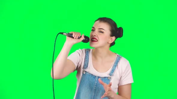 Thumbnail for Pretty Girl Sings Into a Microphone and Moves To the Beat of Music, Slow Motion