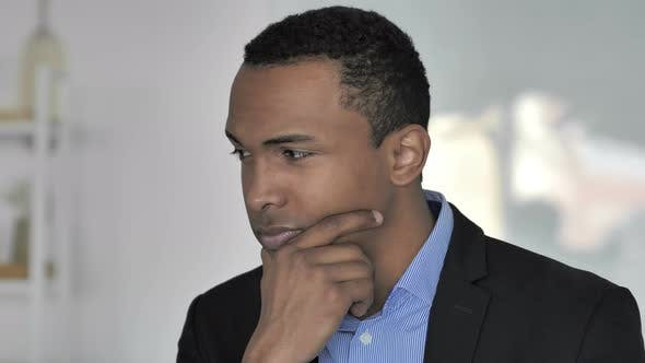 Thumbnail for Depressed Casual Afro-American Businessman Thinking About Problems in Office