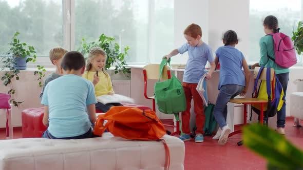 Excited Children Finishing Homework in School