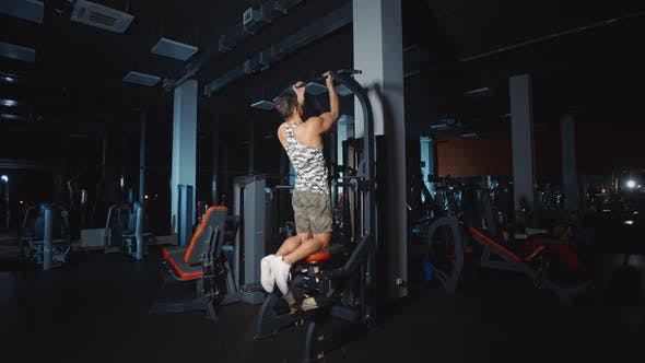 Thumbnail for Bodybuilder Doing Pull Ups Training Hands on Weights Lifting Exercise Machine Work Out in Gym