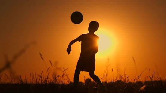 Thumbnail for Silhouette of a Boy Playing Football or Soccer at the Beach with Sunset Background