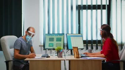 People with Mask and Visor Working