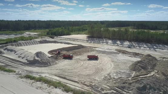 Thumbnail for Dump Truck Loaded with Ore By Digger at Sand Pit Aerial View