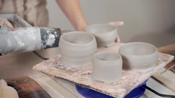 Thumbnail for Ceramist Working with Pottery in Workshop.