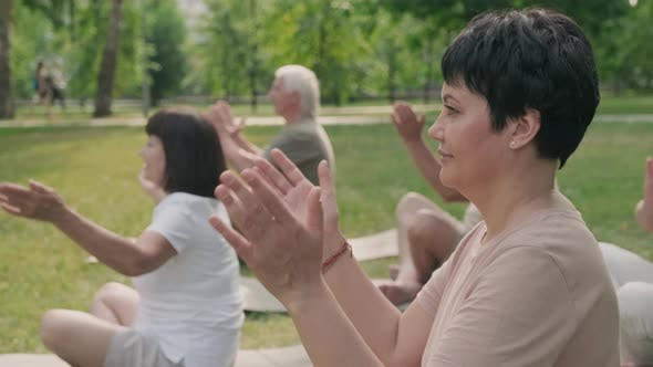 Thumbnail for Woman Doing Yoga with Elderly People in Park