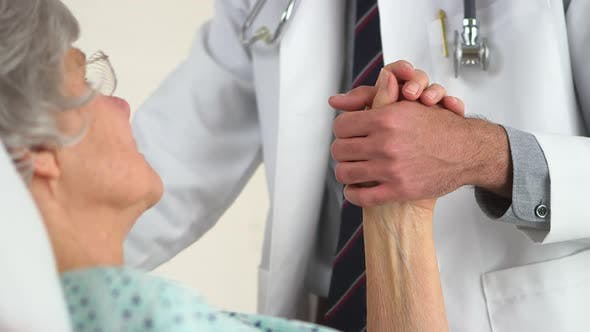 Thumbnail for Closeup of old woman holding Mexican doctor's hand