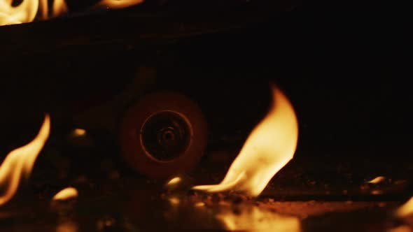 Thumbnail for A skateboard wheel and flames