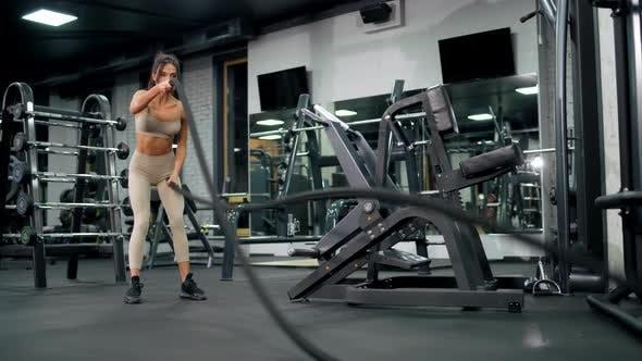 Thumbnail for Fitnesswoman Doing Battle Rope Training.