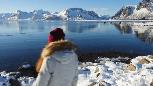 Thumbnail for Girl Taking A Photo Of Sunny Winter Fjord