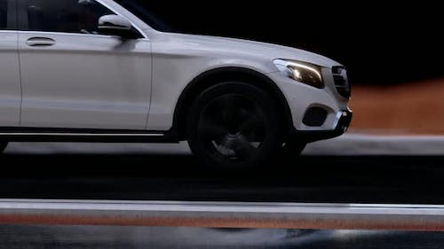 Fast Outgoing White SUV Close Up