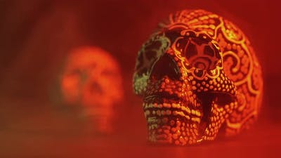 Painted Skull for the Day of the Dead in Red Light with Smoke