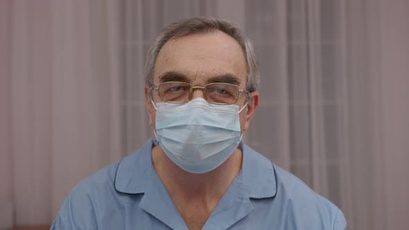 Thumbnail for Senior Man Wore in Medical Mask at Camera