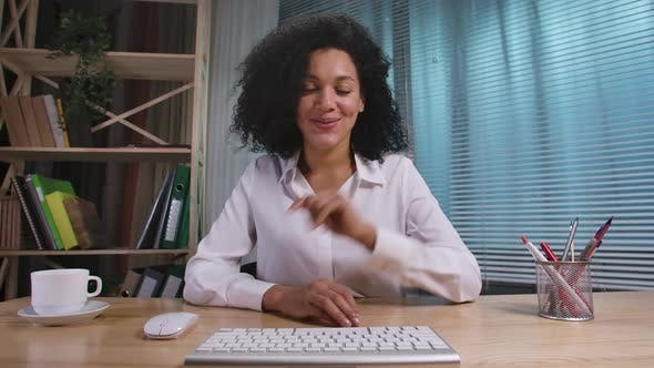 Portrait of African American Woman Talks to Web Camera Making Distance Online Video Conference Call