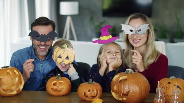Thumbnail for Portrait of happy family spending Halloween together at home