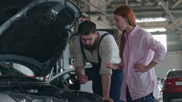Cover Image for Professional Mechanic Looking Car Engine