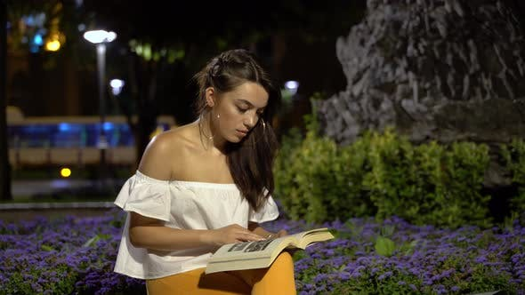 Thumbnail for Woman is Reading a Book in The Park