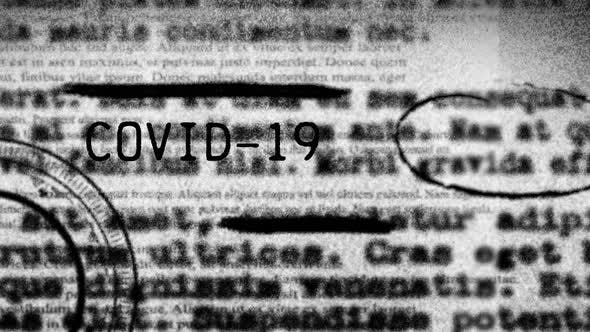 Word Covid-19 written over blurred text with coronavirus  pandemic spreading.