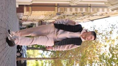 Man in Beige Costume Walking in the City Vertical Video