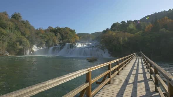 Thumbnail for Waterfall, lagoon and a bridge