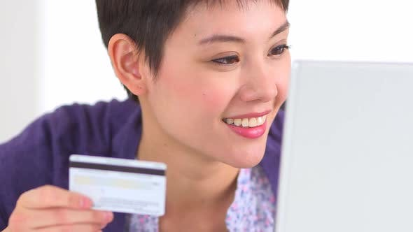 Thumbnail for Chinese woman typing in credit card number