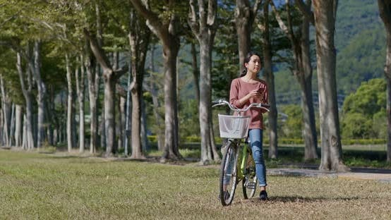 Thumbnail for Woman ride a bike in countryside