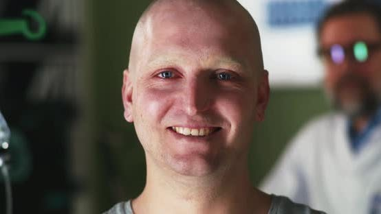 Happy Oncology Patient Smiling at Camera
