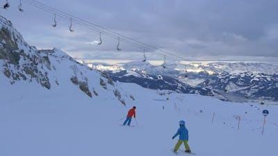 Family skiing on a ski slope